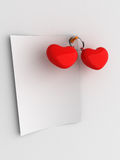 Red hearts blank note. Two red hearts next to blank note paper pinned to white wall Royalty Free Stock Photo
