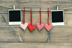 Red hearts blank polaroid photo frame hanging on clothesline Stock Image