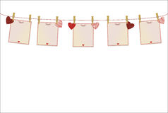 Red hearts and blanks paper with a picture hanging on a rope. Royalty Free Stock Photos