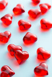 Red hearts on blue background. Stock Photos
