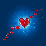 Red Hearts on Blue Background. Blue lovers holiday celebration background with red valentine hearts and blurry lights Royalty Free Stock Photography
