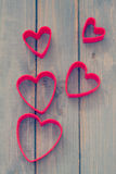 Red hearts on blue background Royalty Free Stock Photos