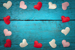 Red hearts on the blue boards Royalty Free Stock Photo