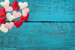 Red hearts on the blue boards Stock Images