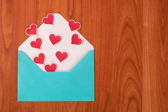 Blue envelope and little heart on wood table for Valentines Day Royalty Free Stock Photos