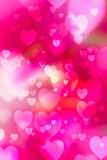 Red hearts bokeh as background stock image