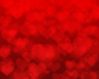 Red hearts bokeh as background Stock Photo