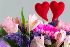 Red hearts and a bouquet of flowers Stock Photo