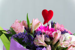 Red hearts and a bouquet of flowers Royalty Free Stock Image