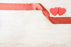 Red hearts with bow Royalty Free Stock Photography
