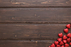 Red hearts. On a brown wooden background. Valentine's Day Royalty Free Stock Photos