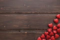 Red hearts. On a brown wooden background. Valentine's Day Royalty Free Stock Image