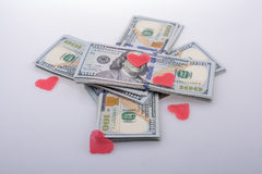 Red hearts and bundle of US dollar Royalty Free Stock Images