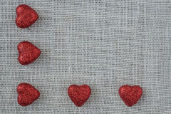 Red Hearts on Burlap Background Royalty Free Stock Photography