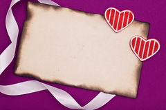 Red hearts and burnt blank paper Stock Photo