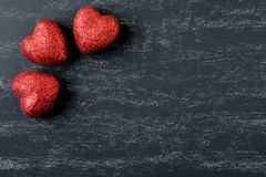 Red Hearts on a Chalkboard Stock Photography