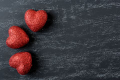 Red Hearts on a Chalkboard Stock Photo