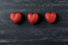 Red Hearts on a Chalkboard Stock Images
