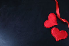Red hearts on the chalkboard. Royalty Free Stock Photo