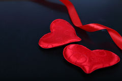 Red hearts on the chalkboard. Stock Images