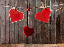 Red hearts with clothespin hanging on clothesline Royalty Free Stock Images