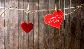 Red hearts with clothespin hanging on clothesline Royalty Free Stock Image