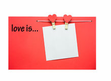 Red hearts with clothespins hanging on clothesline isolated on white background Stock Photos