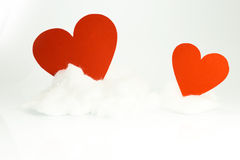 Red hearts on a cloud Stock Image