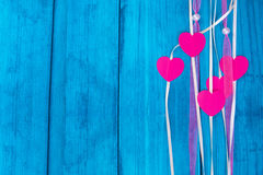 Red hearts on a colored rope Royalty Free Stock Photos