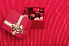 Red hearts confetti on fabric background Stock Photography