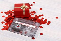 Red hearts confetti on retro wooden background Royalty Free Stock Images