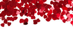 Red hearts confetti on white background Royalty Free Stock Image