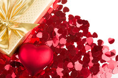 Red hearts confetti on white background. Small red hearts confetti and present box isolated on white background Royalty Free Stock Images