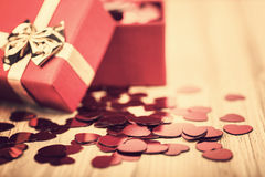 Red hearts confetti on wooden background in retro color Royalty Free Stock Photo