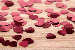 Red hearts confetti on wooden background Stock Photo