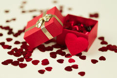 Red hearts confetti on wooden background Royalty Free Stock Image