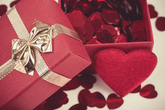 Red hearts confetti on wooden background Stock Photos