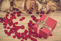 Red hearts confetti on wooden background Royalty Free Stock Photos