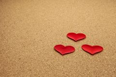 Red hearts on cork background. Valentines and 8 March Mother Women`s Day concept royalty free stock photos