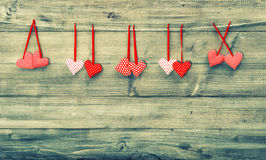 Red hearts couples. Valentines Day concept. Instagram style toned picture Royalty Free Stock Image