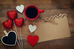 Red hearts and cup of coffee on wooden background Royalty Free Stock Image