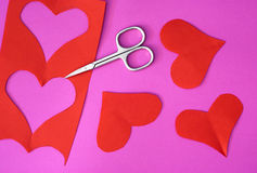Red hearts cut out with metal scissors Stock Image