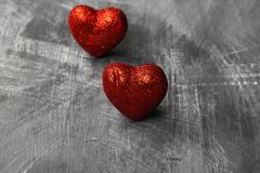 Red hearts on a dark background.  Royalty Free Stock Photo