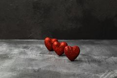 Red hearts on a dark background.  Stock Image