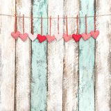 Red hearts decoration hanging Valentines day greetings card. Red hearts decoration hanging on wooden background. Valentines day greetings card Stock Photography