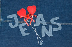 Red hearts and denim letters. Royalty Free Stock Images
