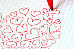 Red hearts drawn on a sheet Royalty Free Stock Image