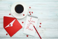 Red hearts with envelope and cup of coffee. On wooden table Royalty Free Stock Photography