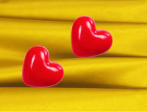 Red hearts on fabric background Stock Photo