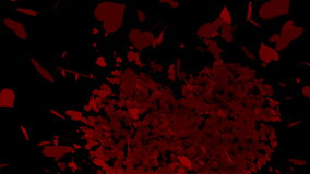 Red hearts falling on black surface stock footage
